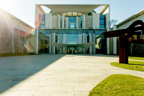 Sky City Sun Architecture Grass Berlin City life Modern Concrete Copy Space Lawn Fence Capital city Area Dazzle Government