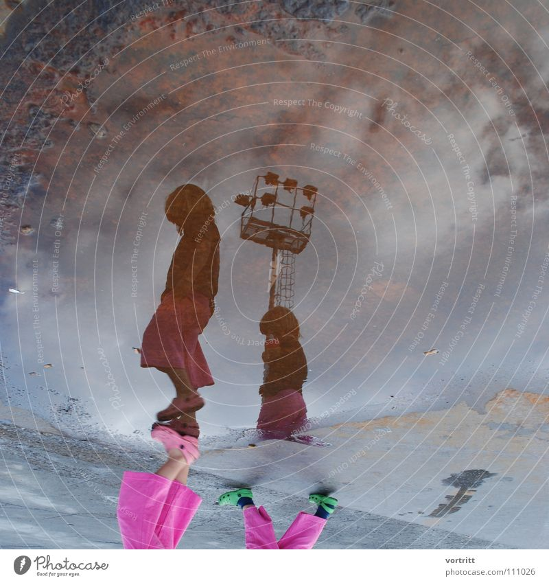 2 h before departure Child Girl Reflection Puddle Pink Style Inverted Clouds To go for a walk Gray Daughter Floodlight Rust Sky Trashy Street