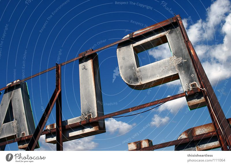 nightmare Letters (alphabet) Capital letter Watchfulness Clouds Steel Remote Vantage point Detail Joy Summer Characters Advertising Blue Sky Scaffold hotel roof