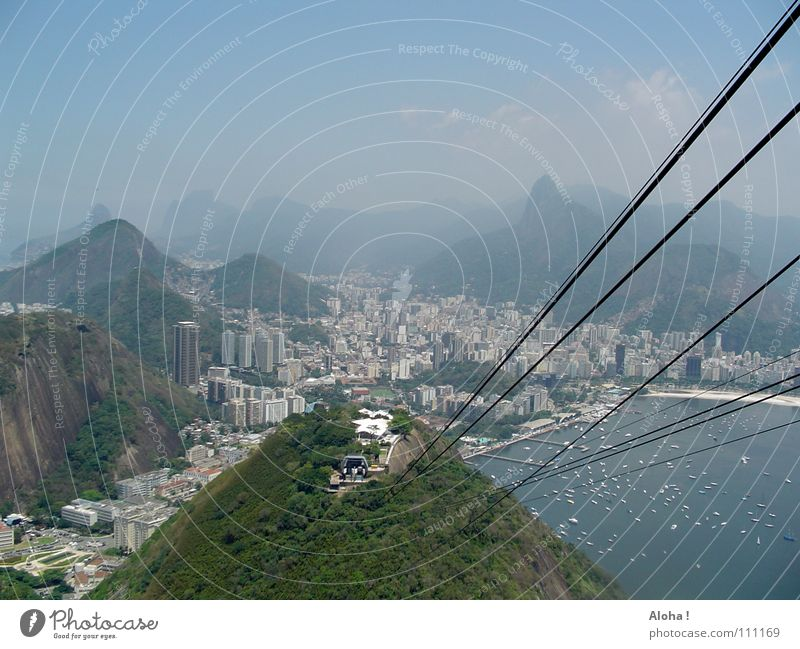 Water City Far-off places Mountain Coast Rock Rope Hill Skyline Steel cable Bay Vantage point Landmark Tourist Attraction Sightseeing Downward