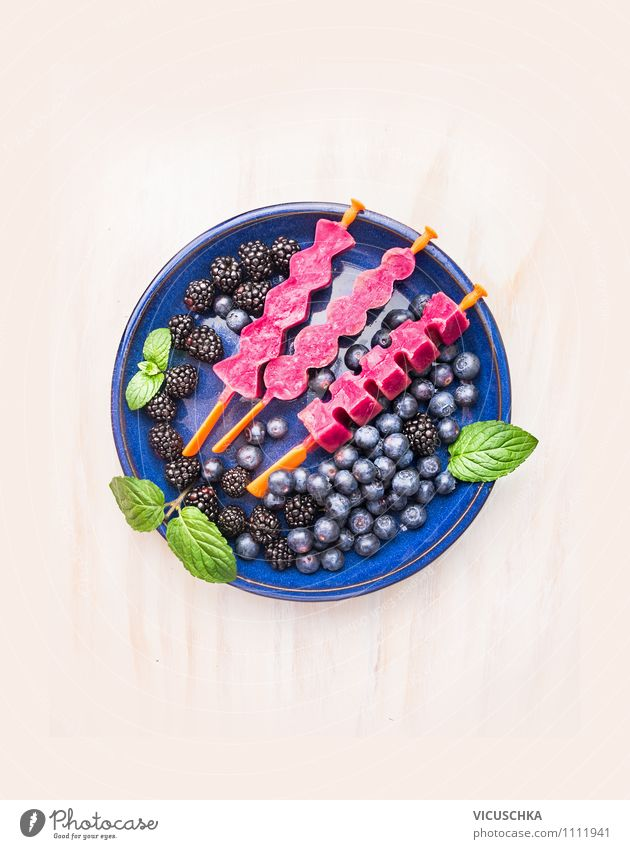 Fruit juice ice cream on a stem in blue plate with berries Food Dessert Nutrition Organic produce Vegetarian diet Diet Juice Plate Style Design Healthy Eating