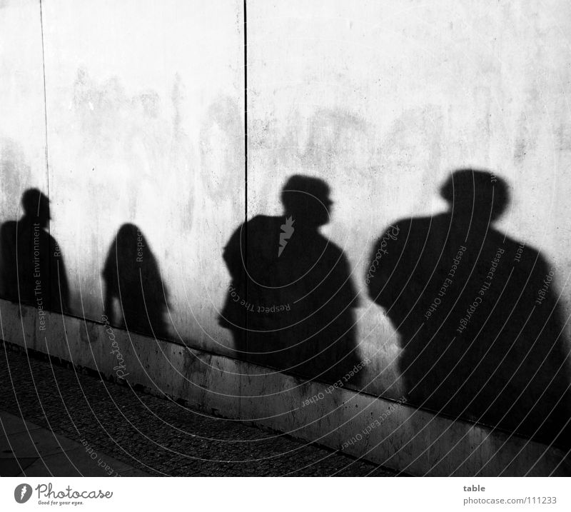 shady world Light Evening sun Man Woman Girl Concrete Wall (barrier) Wall (building) Gray Town Sidewalk Shadowy existence Shadow play Dark side Closing time