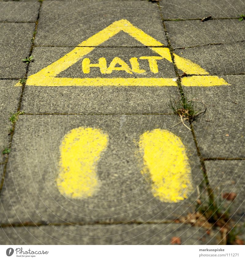 STOP Sidewalk Mobility Recommendation Dangerous Stop Hold Footprint Yellow Warning label Warning sign Street Signs and labeling Threat Feet Town