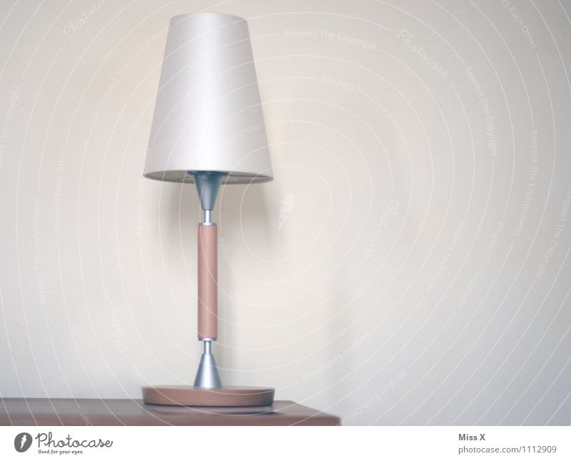 Simple Interior design Decoration Furniture Lamp Table Illuminate Bedside table Reading lamp Colour photo Subdued colour Interior shot Deserted Copy Space right