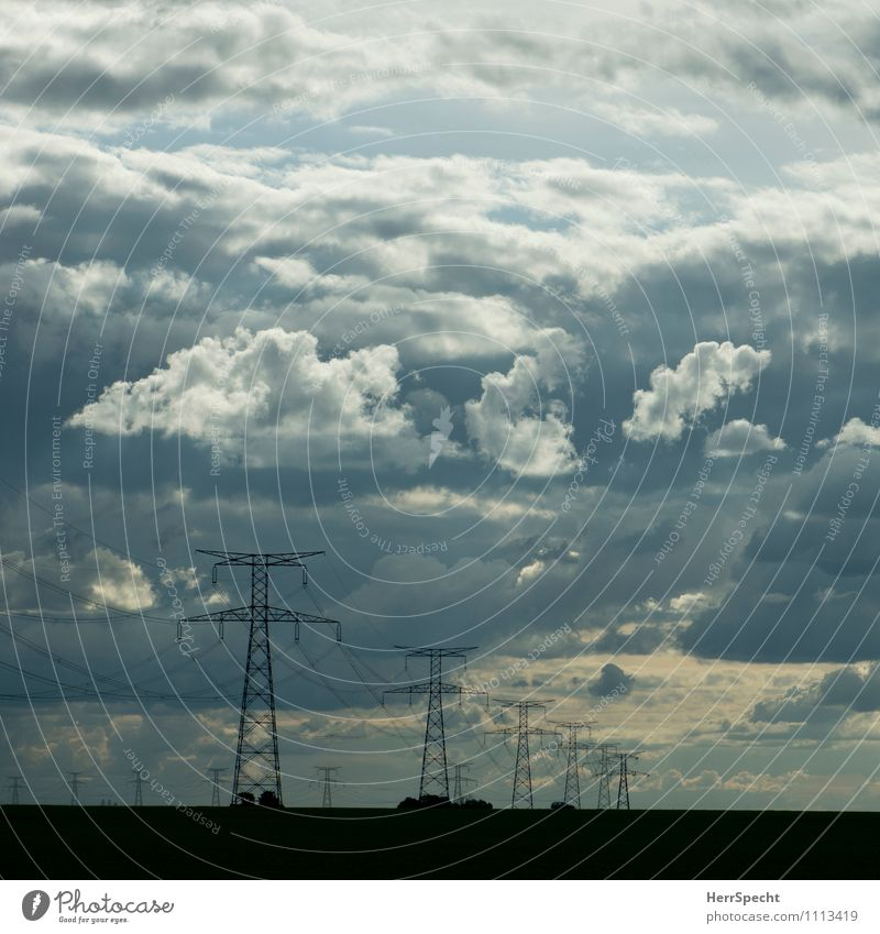 POWER Energy industry Electricity pylon High voltage power line Landscape Sky Clouds Esthetic Threat Gray Clouds in the sky Cloud formation Dusk Perspective Row