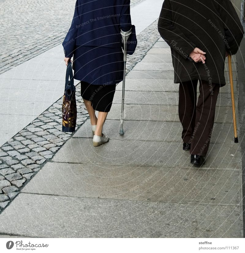 Human being Old Blue White City Black Senior citizen Healthy Together Power Walking Poverty Shopping In pairs To go for a walk Trust