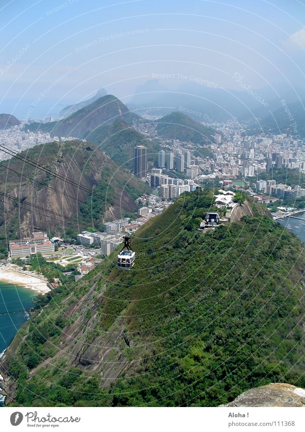Water City Ocean Mountain Rock Hill Harbour Skyline Vantage point Landmark Tourist Attraction Sightseeing Brazil Famousness Means of transport Atlantic Ocean