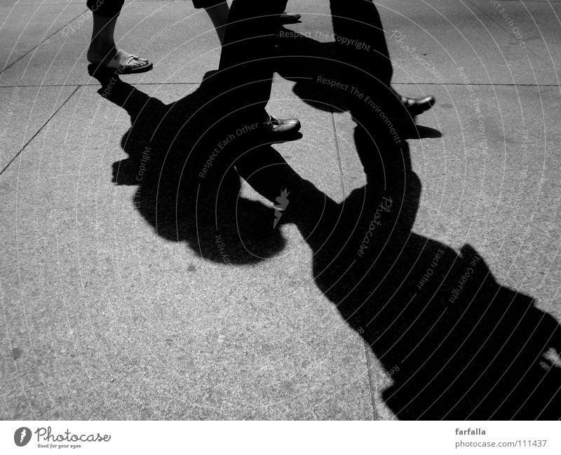 streetlife Human being Pedestrian Footwear Light Dark road Shadow walking Black & white photo black/white Feet light/dark