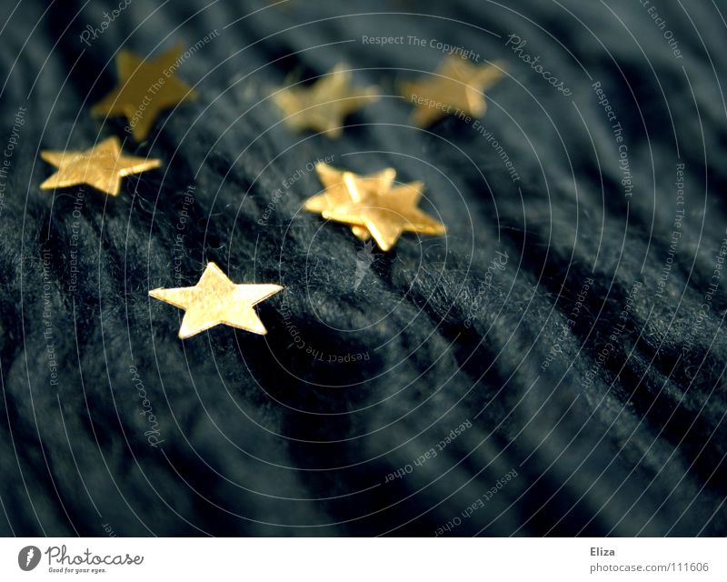 Golden stars on blue fabric. Christmas & Advent Europe Star (Symbol) Waves Blue Winter Cloth Thread Glimmer Symbols and metaphors Embellish Fame Glittering