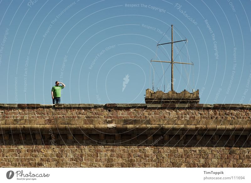 Man Sky Green Blue Stone Wall (barrier) T-shirt Vantage point Castle Monument Historic Spain Landmark Sail Barcelona