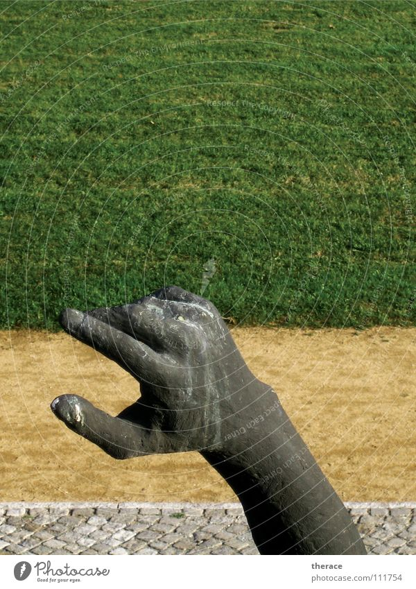 Hand Green Summer Meadow Grass Lanes & trails Park Metal Arm Fingers Lawn Communicate Direction Monument Signage Historic