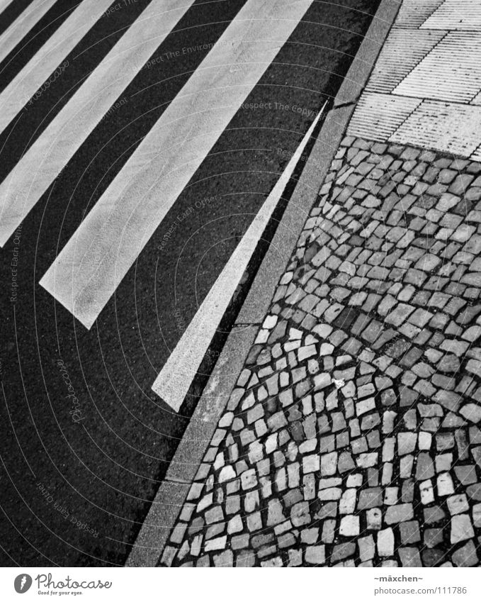 zebra crossing Zebra crossing Street crossing Dangerous Cobblestones Curbside Black White Square Diagonal Stripe Asphalt Hard Going Traverse Yield sign