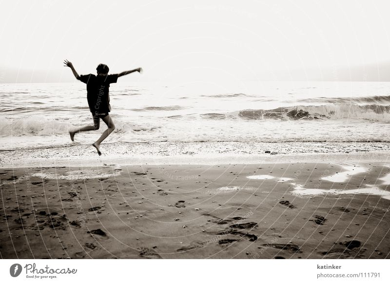home Ocean Jump Applause Homesickness Wanderlust Beach Black White Moody Joy Black & white photo Sepia Sand