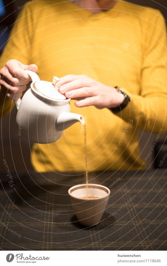 serve the tea Beverage Tea Black tea Pot Mug Tea cup Teapot Joy Man Adults Hand Fingers 1 Human being Table To hold on Elegant Friendliness Brown Yellow Gold