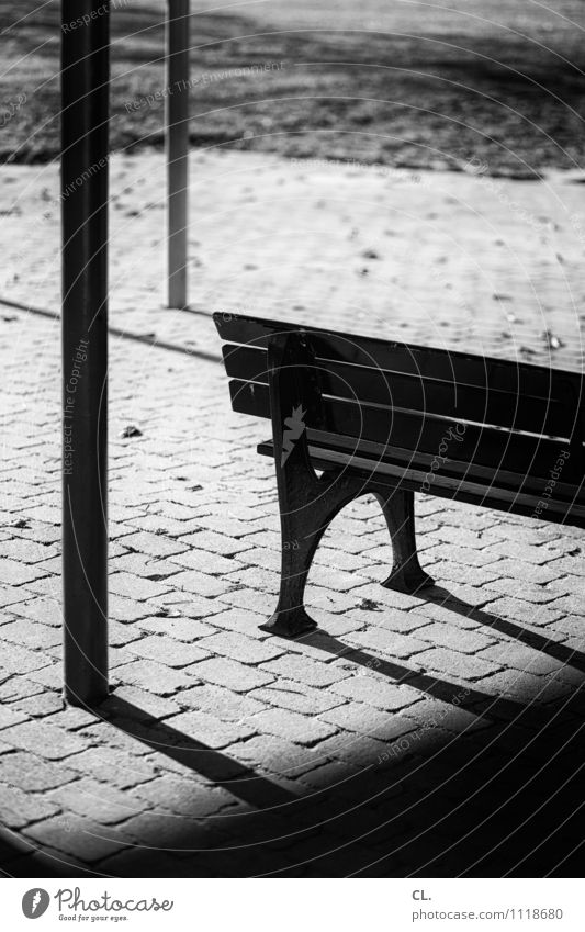 bench Meadow Ground Bench Wait Loneliness Stagnating Black & white photo Exterior shot Deserted Day Light Shadow Contrast Shallow depth of field