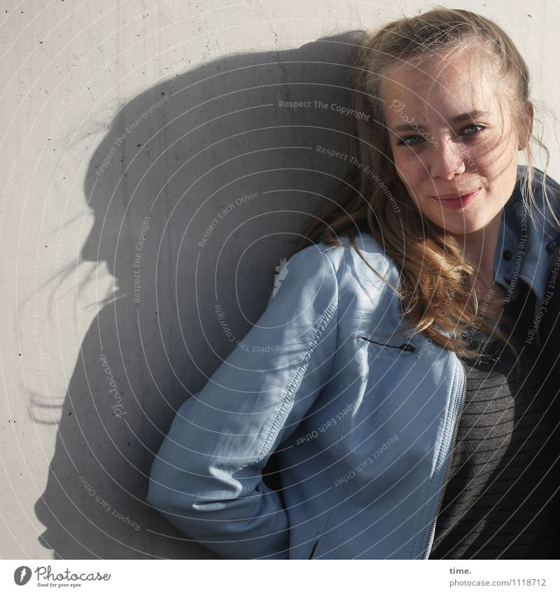 . Feminine Young woman Youth (Young adults) 1 Human being Wall (barrier) Wall (building) T-shirt Jacket Blonde Long-haired Observe Smiling Looking Wait