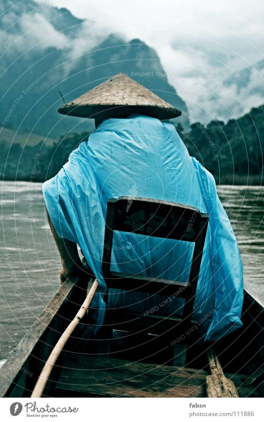FULL MOON II Watercraft Driver Virgin forest Laos Bad weather Wood Practical Raincoat Plastic bag Asia River Brook upriver Upward Clouds Mountain Simple