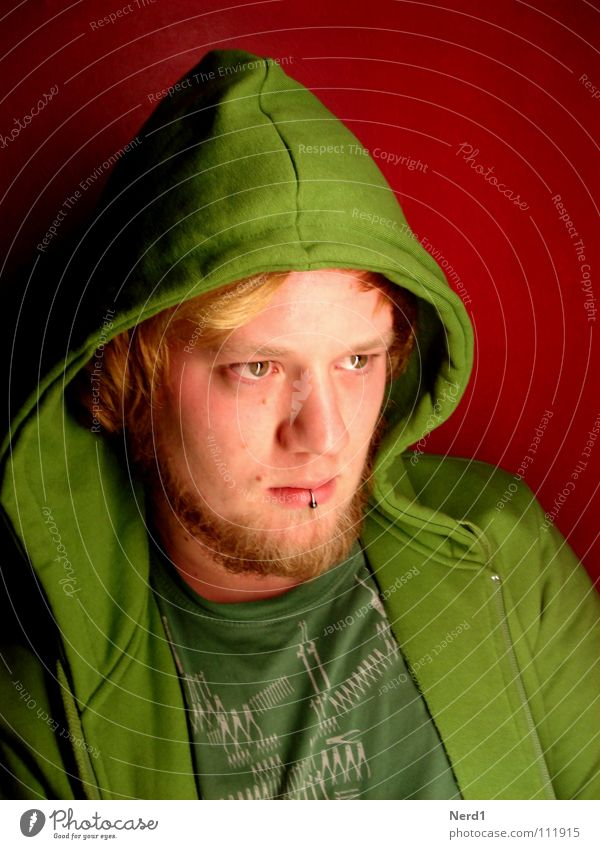 Man Youth (Young adults) Green Red Face Eyes Blonde Observe Concentrate Expressionless 18 - 30 years Piercing Hooded (clothing) Earnest Goatee