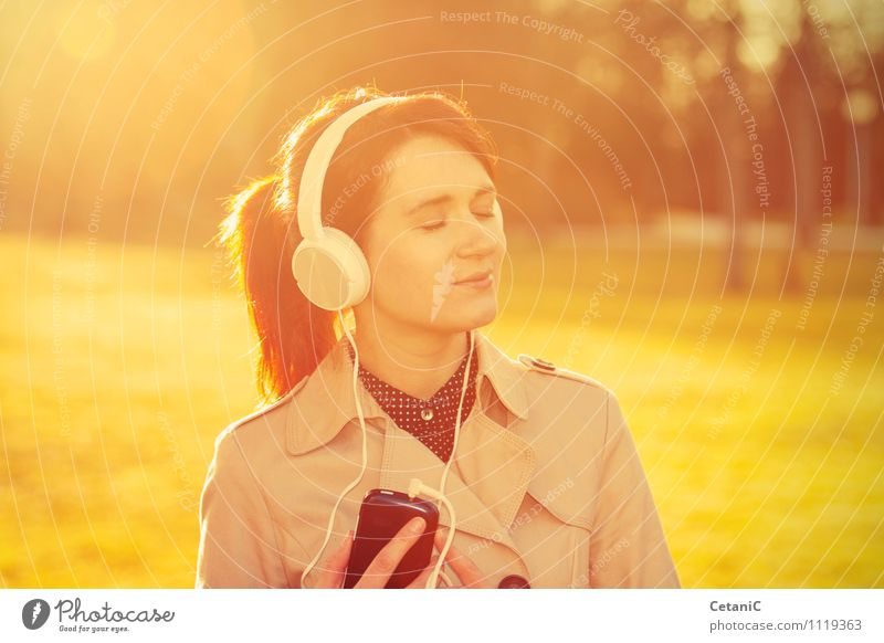 Woman listening to music in sunlight. Woman Nature Youth (Young adults) Young woman Relaxation Joy 18 - 30 years Adults Life Love Feminine Happy Freedom Lifestyle Park Dream