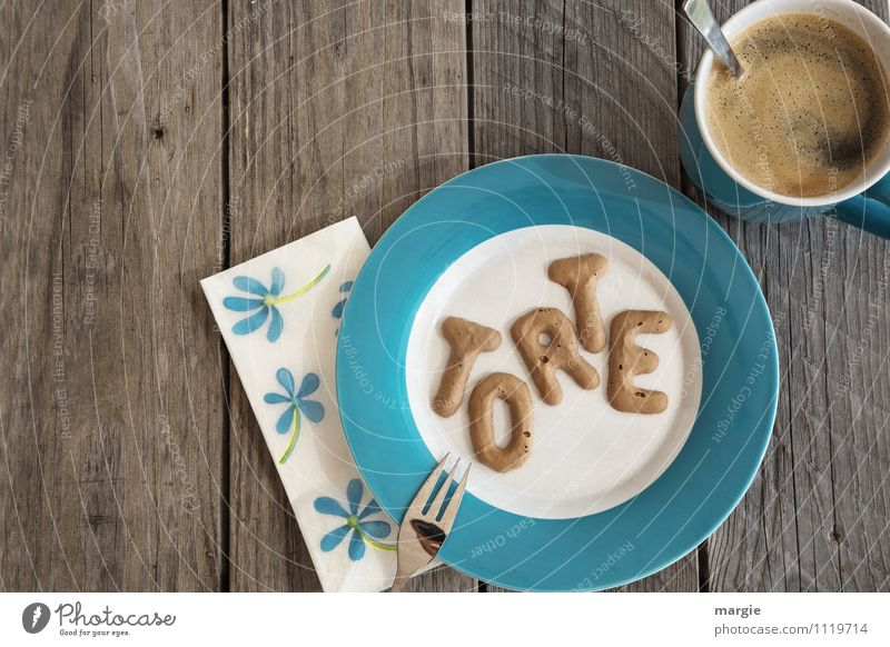 The letters TORTE on a plate with napkin and a cup of coffee with spoon on a rustic wooden table Food Cake Candy To have a coffee Vegetarian diet Beverage