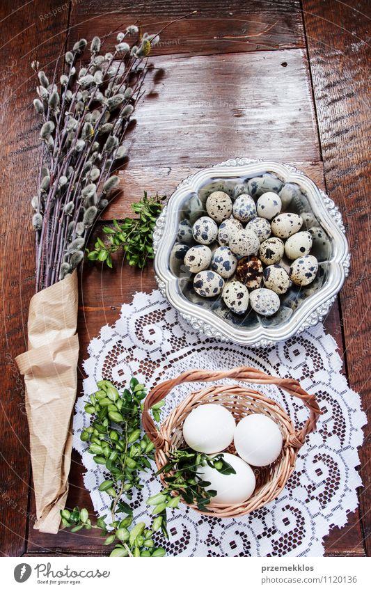 Easter composition of eggs, catkins and boxwood on wooden table Decoration Table Spring Paper Wood Metal Natural Brown Green Tradition Basket bobwhite candid