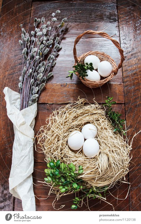 Easter composition of eggs and catkins on wooden table Decoration Table Spring Paper Wood Natural Brown Green Tradition boxwood candid Egg Hay Nest straw Top