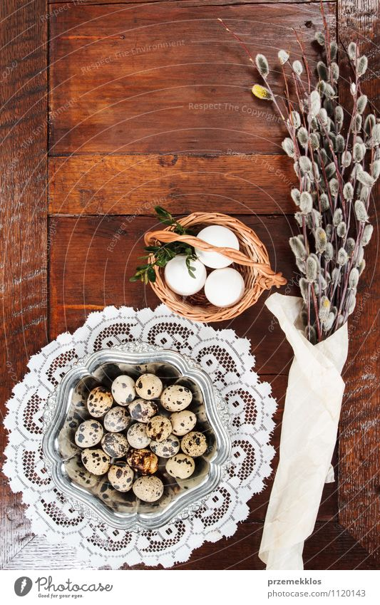 Easter composition of catkins and eggs on wooden table Decoration Table Spring Paper Wood Metal Natural Brown Tradition Basket bobwhite candid Copy Space Dish