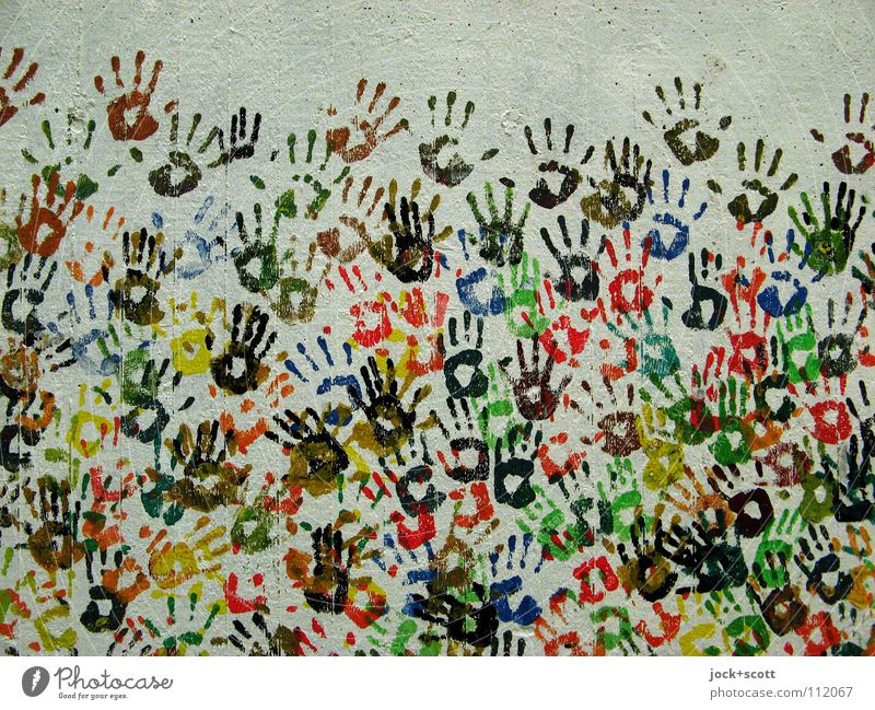 Hand in Hand Joy Crowd of people Street art Berlin Wall (barrier) Wall (building) Collection Concrete Sign Imprint Touch Happiness Together Many Moody
