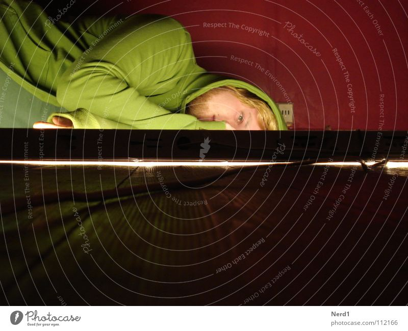 tired Green Red Light Man Blonde Wood Boredom Lie Wooden floor Facial expression Detail of face Partially visible Hopelessness Exhaustion Hooded sweater