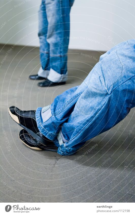 double denim Concrete Stand Outstretched Footwear Relaxation Uniqueness Washed out Pants Gray Landscape format Colour photo Working man Foreground