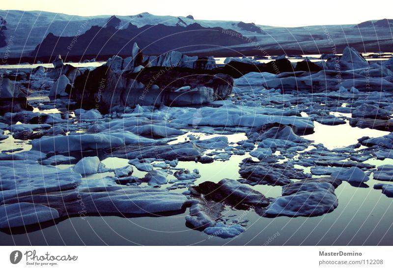 I began... Glacier Glacier ice Perpetual ice Melt Snow melt Lagoon Iceberg Cold Float in the water Iceland Dusk Sunset Twilight Calm Black Freeze Frost calve