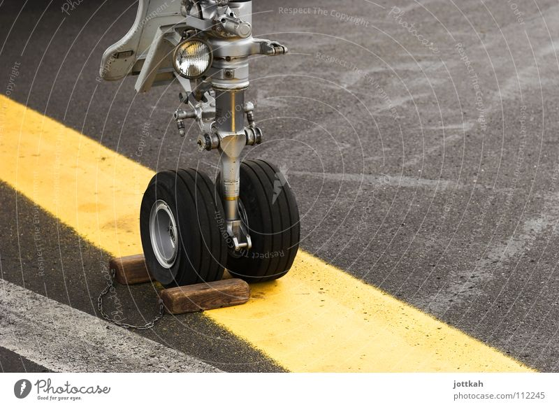 Skid mark? Airplane Car body Brakes Stop Hold Stand Line Yellow Lane markings Asphalt Break Safety Aviation Wheel thwarted Brake pad Signs and labeling wheels