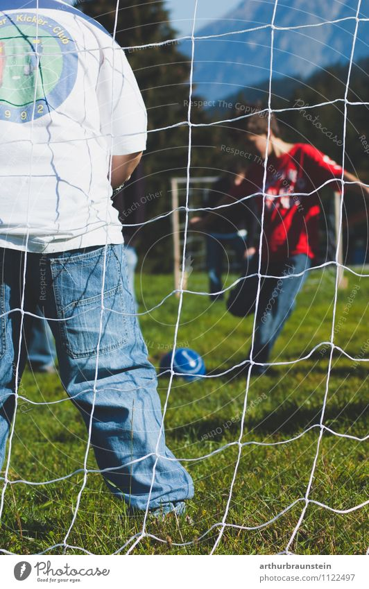 Football goal Leisure and hobbies Playing Soccer Summer Summer vacation Sun Sports Ball sports Sports team Football pitch Child Human being Masculine
