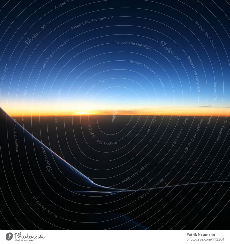 Sky Sun Blue Red Black Clouds Yellow Far-off places Cold Window Warmth Moody Airplane Flying Aviation Technology