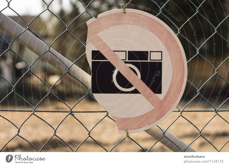 "Broken ""No photography"" sign on wire mesh fence Take a photo Industry Construction site Fence Metal Signage Warning sign Old Hideous Gloomy End Mysterious"