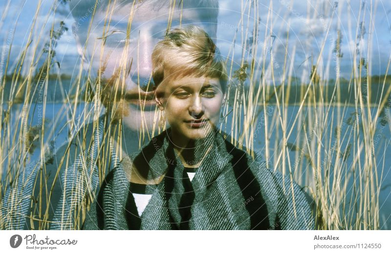 analogue double exposure of a young woman standing in front of reeds at a lake Trip Adventure Far-off places Freedom Young woman Youth (Young adults) Face