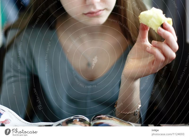 An apple a day Apple Nutrition Eating Finger food Lifestyle Leisure and hobbies Reading Girl Young woman Youth (Young adults) Face Hand 1 Human being