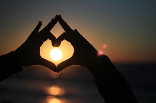 Human being Vacation & Travel Sun Hand Love Art Contentment Esthetic Heart Symbols and metaphors Sunbathing Solar Power Heart-shaped Vacation mood