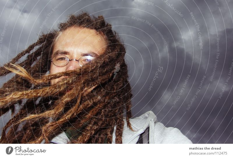 HAIR vs. wind Clouds Dark Gray Threat Wind Gale Storm Bad weather Deep Man Long-haired Dreadlocks Hang Judder Eyeglasses Flash photo Slate blue