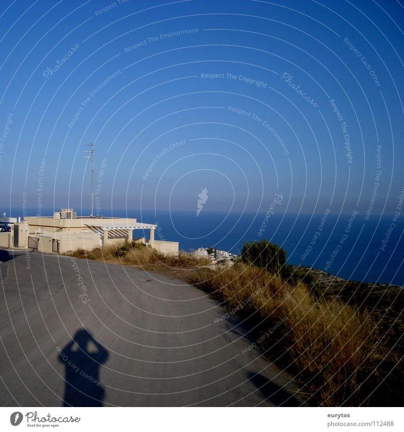 Sky Ocean Blue Summer Vacation & Travel House (Residential Structure) Far-off places Street Freedom Warmth Landscape Coast Horizon Island Asphalt Physics