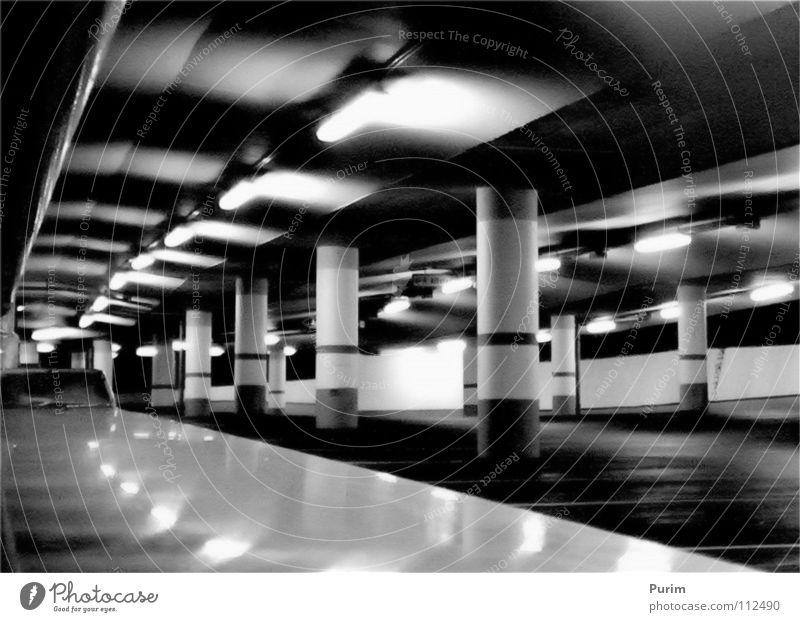 vanishing point Parking garage Night Black White Thriller Vanishing point Tunnel Contrast Architecture