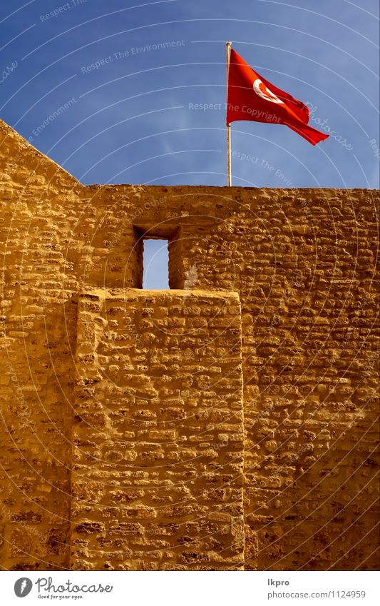 flag in the w Sky Clouds Castle Flag Blue Brown Red White wall tunisi Tunisia brick window Colour photo