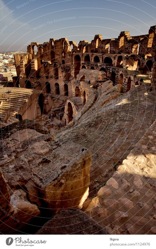 from inside of arena Sand Sky Clouds Rock Ruin Stone Historic Brown Yellow Gray Red Black White el jem Arena coliseum gold Tunisia brick ancien curved arcuated