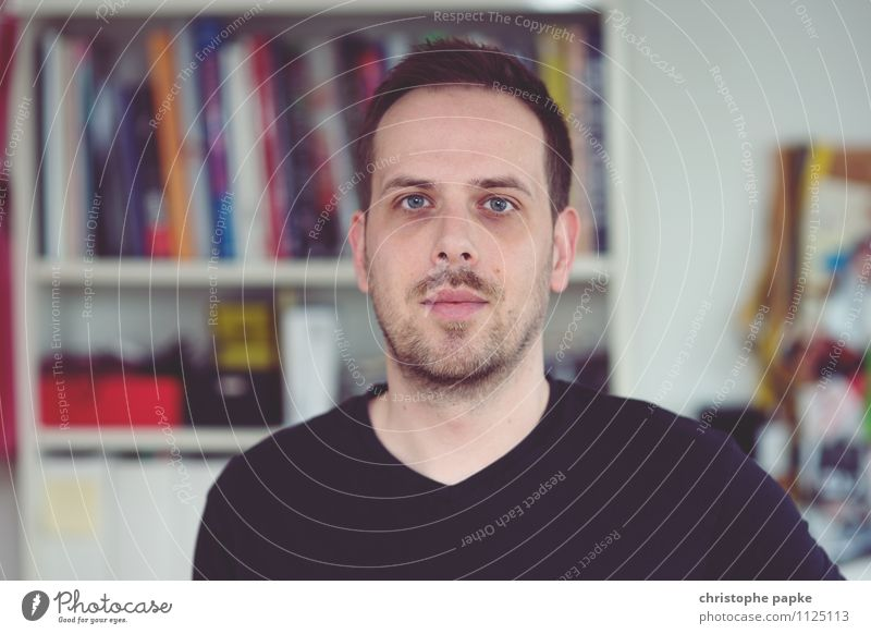 young man looks into the camera, bookshelf in the background Human being Young man Flat (apartment) Adults Looking Selfie portrait Man Living or residing