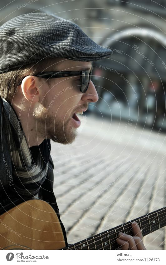 street musicians Young man Youth (Young adults) Singer Musician Guitar Busker Guitarist Sunglasses Scarf Hat Facial hair Uniqueness Exterior shot