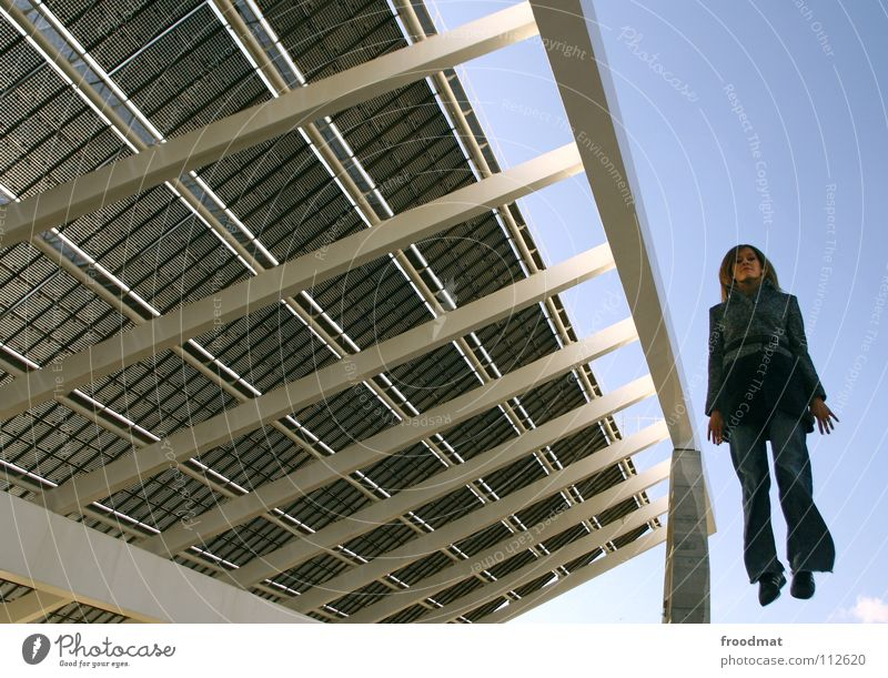 Woman Sky Hand Cold Architecture Jump Blonde Fingers Perspective Renewable energy Roof Jeans Diagonal Solar Power Spain Hover