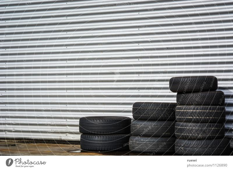 tire stacks Racecourse Workplace Trade Services Technology Wall (barrier) Wall (building) Transport Means of transport Motoring Tire Old New Black Silver Safety