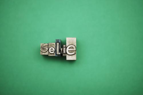 Green Metal Photography Letters (alphabet) Camera Self-confident Pencil Take a photo Self portrait Conceited Egotistical Photographic studio Lead Selfie