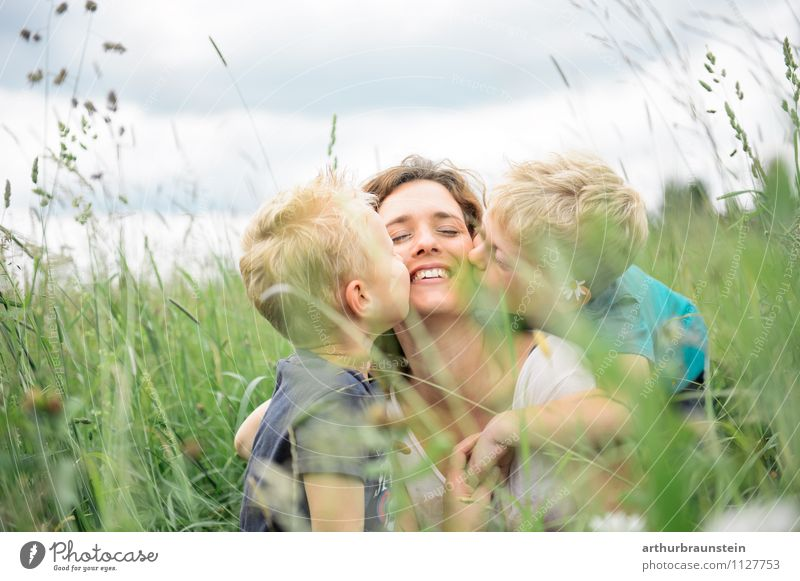 Children kiss their beloved smiling mommy in the high grass luck Leisure and hobbies Vacation & Travel Trip Summer Mother's Day Human being Masculine Feminine