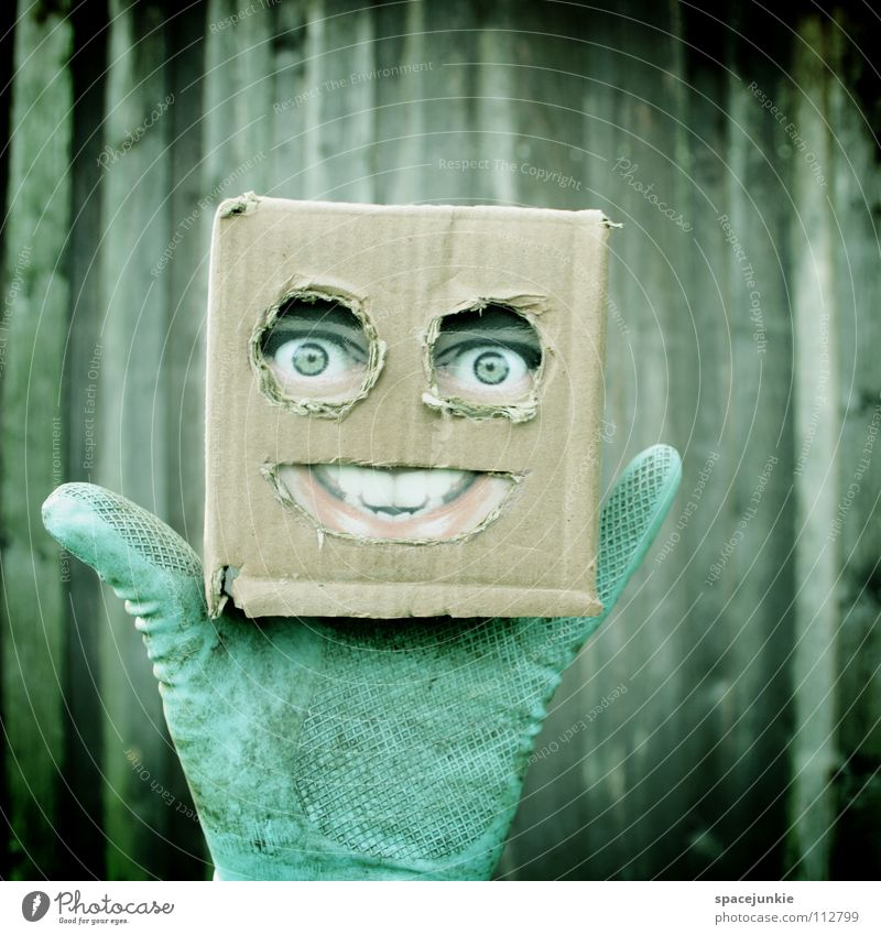 Living in a box Man Cardboard Whimsical Humor Wall (building) Freak Square Wood Gloves Glove puppet Joy Face Mask Hiding place Hide square skull